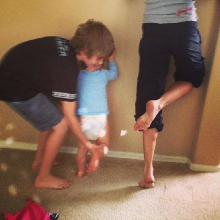 Stretching my calves with the kids help!