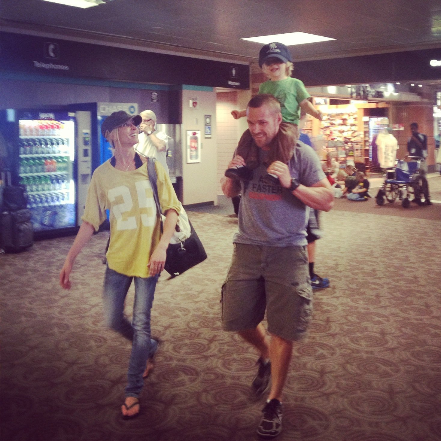 Chris, Cash and I celebrating  Walk to Work Day! Yes, we're in an airport!! Yes, we are walking to work!  - Learn more at https://heidipowell.net/1102