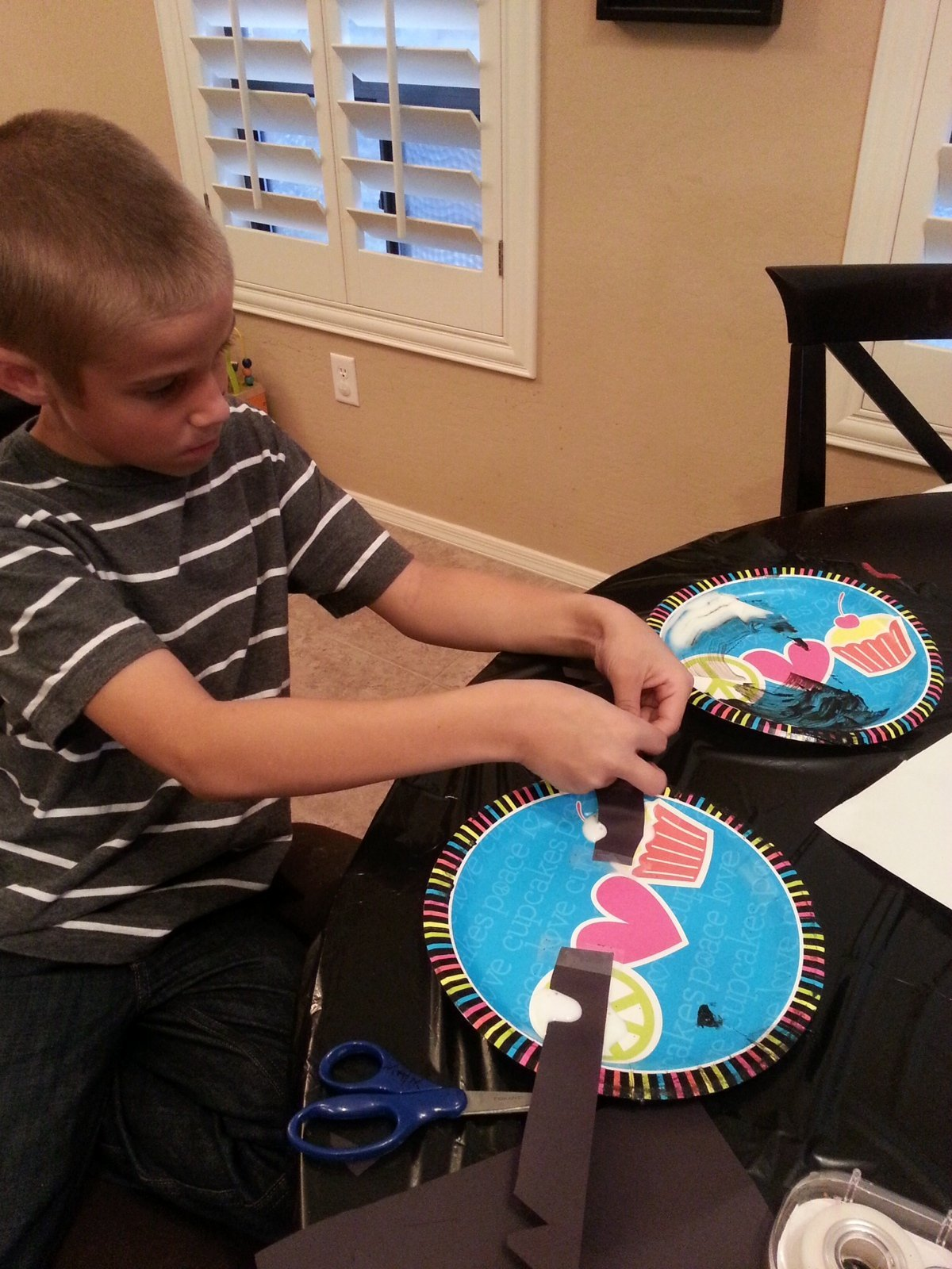Matix adding decorations to his monster mask https://heidipowell.net/4029