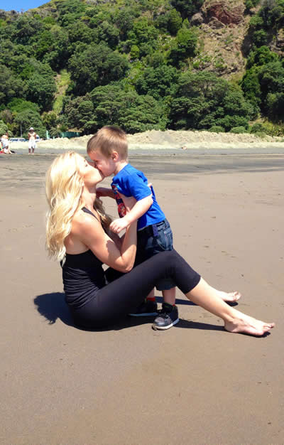 Heidi kissing Cash NZ beach-opt
